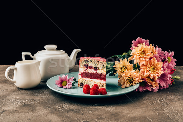 delicious piece of cake with raspberries, beautiful flowers and kettle with porcelain jug Stock photo © LightFieldStudios