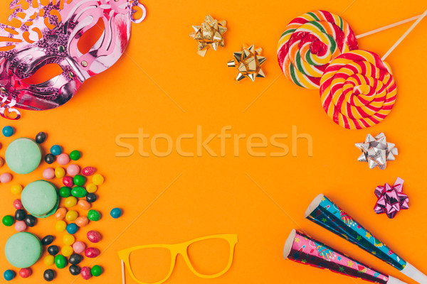 flat lay with candies and and party objects isolated on orange, purim holiday concept Stock photo © LightFieldStudios