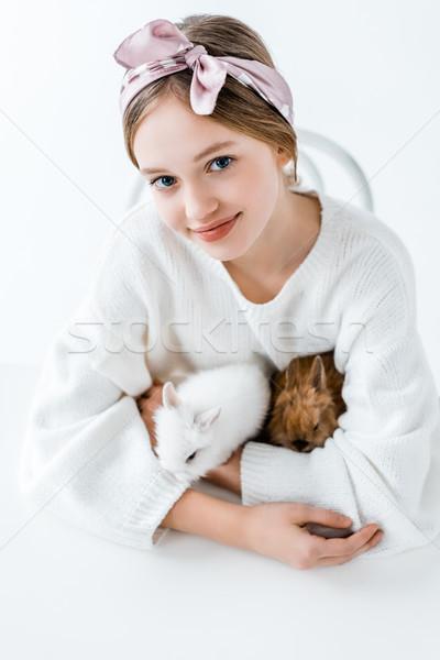 Cute niña feliz peludo conejos sonriendo Foto stock © LightFieldStudios