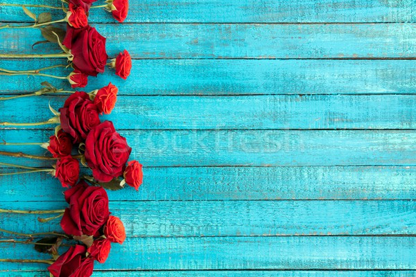 red roses on table Stock photo © LightFieldStudios