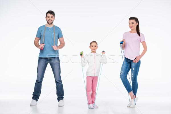 Gülen genç aile atlamak halatlar beyaz Stok fotoğraf © LightFieldStudios