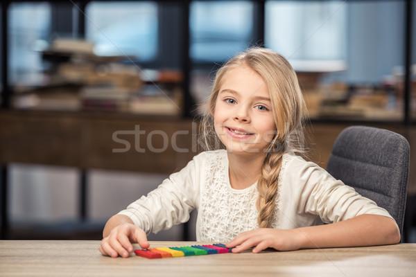 Girl playing with plasticine Stock photo © LightFieldStudios