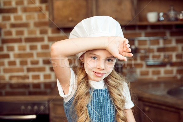 portrait of little girl in chef hat and flour on face Stock photo © LightFieldStudios