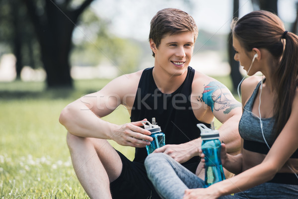 sportive couple resting in park Stock photo © LightFieldStudios