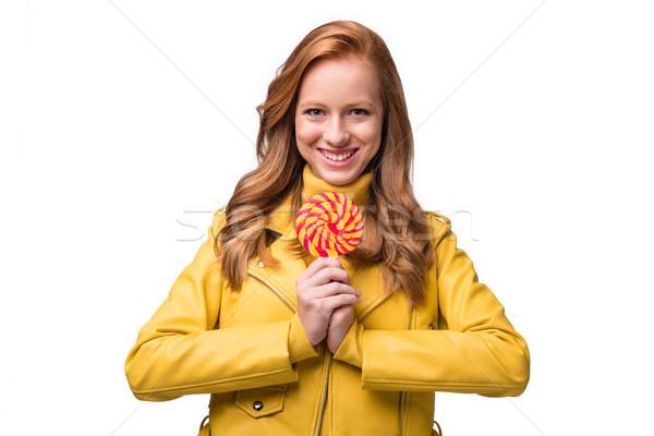 Elegancki dziewczyna lizak atrakcyjny żółty Zdjęcia stock © LightFieldStudios