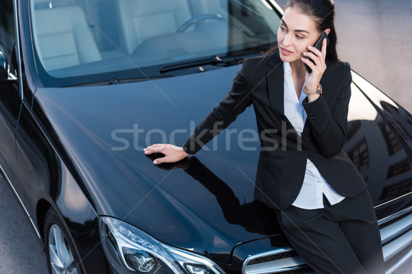 woman on car talking on phone Stock photo © LightFieldStudios