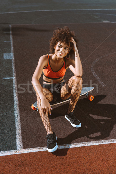 african-american woman on longboard Stock photo © LightFieldStudios
