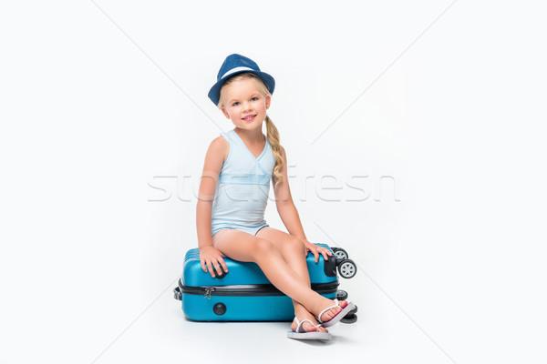 child in swimsuit sitting on suitcase  Stock photo © LightFieldStudios