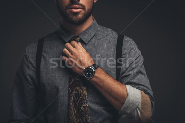 man adjusting tie Stock photo © LightFieldStudios