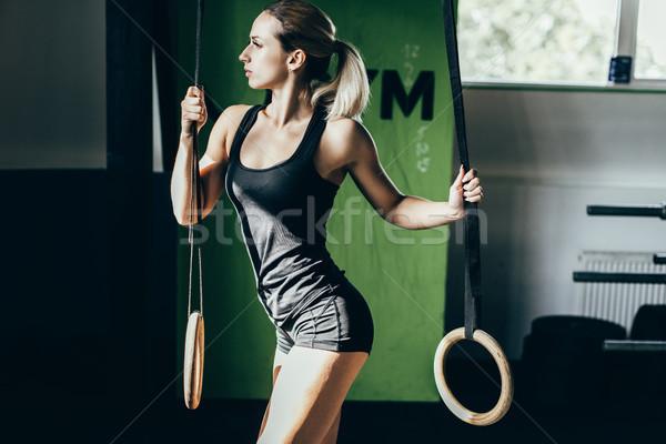 Sportoló pózol gimnasztikai gyűrűk fiatal sportos Stock fotó © LightFieldStudios