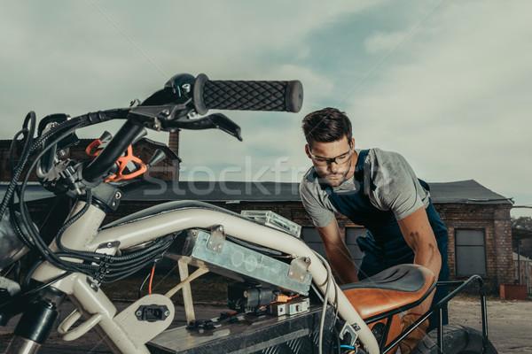 repairing vintage motorcycle Stock photo © LightFieldStudios