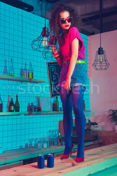 woman in sunglasses standing on counter Stock photo © LightFieldStudios
