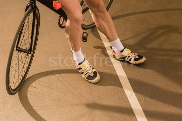 cyclist standing near bicycle Stock photo © LightFieldStudios