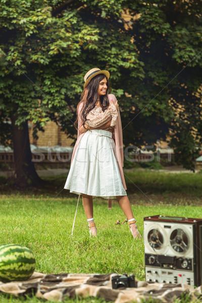 笑みを浮かべて 少女 麦わら帽子 美しい 立って ストックフォト © LightFieldStudios