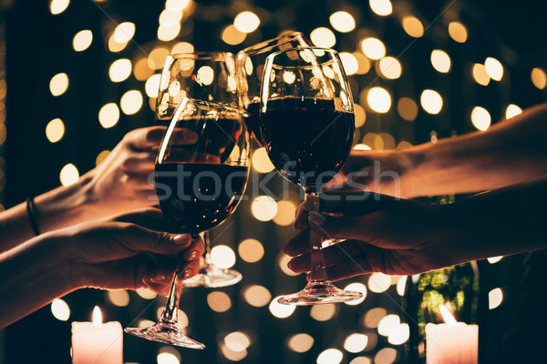 people clinking glasses with wine Stock photo © LightFieldStudios