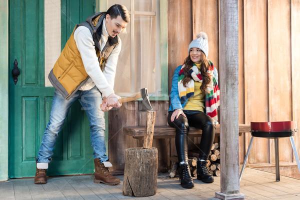 Gülen genç kadın bakıyor yakışıklı adam yakacak odun Stok fotoğraf © LightFieldStudios