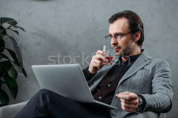 Stock photo: businessman using laptop
