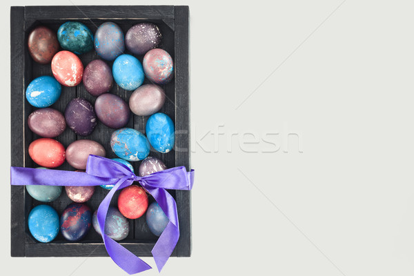 top view of gift box with colorful easter eggs, isolated on white Stock photo © LightFieldStudios