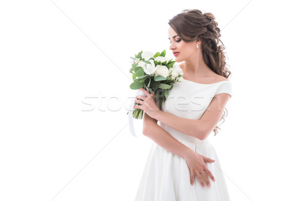 elegant bride posing in traditional white dress with wedding bouquet, isolated on white Stock photo © LightFieldStudios