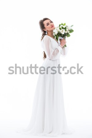 dreamy bride posing in dress with wedding bouquet, isolated on white Stock photo © LightFieldStudios