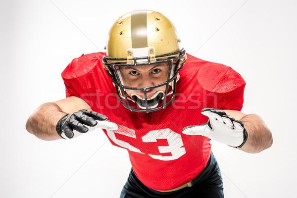 Amerikaanse voetballer helm sportkleding naar camera Stockfoto © LightFieldStudios