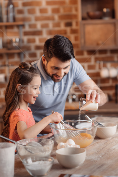 'portrait of father and daughter making cookies in kitchen Stock photo © LightFieldStudios