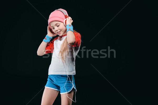 Mosolyog kislány sportruha visel fejhallgató pózol Stock fotó © LightFieldStudios