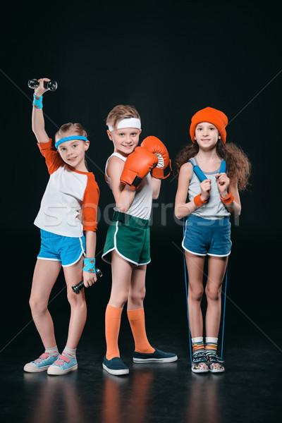 Tre attivo ragazzi abbigliamento sportivo posa sport Foto d'archivio © LightFieldStudios