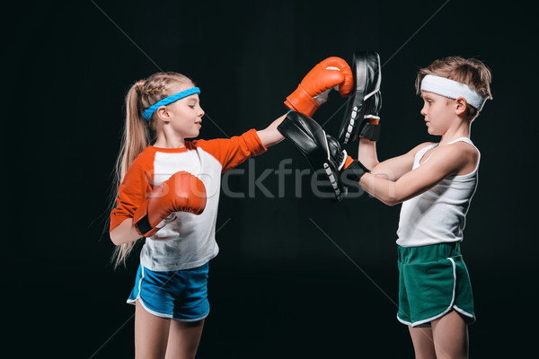 side view of kids pretending boxing isolated on black, active kids concept Stock photo © LightFieldStudios