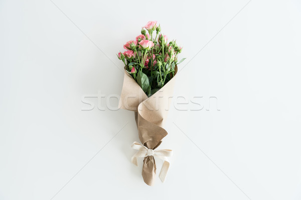 pink roses bouquet in kraft paper isolated on white with copy space, wedding flowers bouquet concept Stock photo © LightFieldStudios