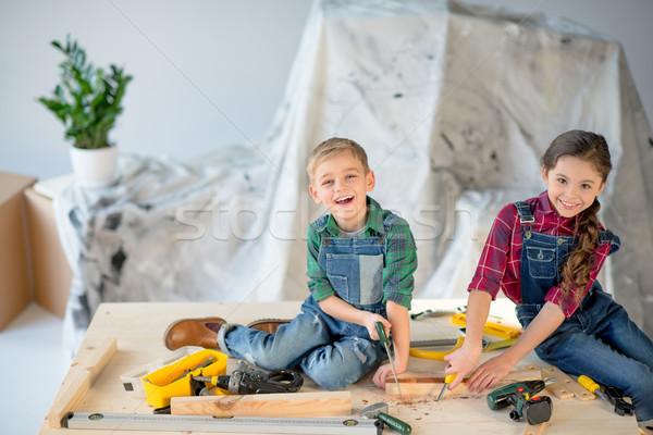 Kids sawing wooden plank Stock photo © LightFieldStudios