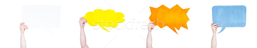Partial view of people people holding blank speech bubbles isolated on white Stock photo © LightFieldStudios