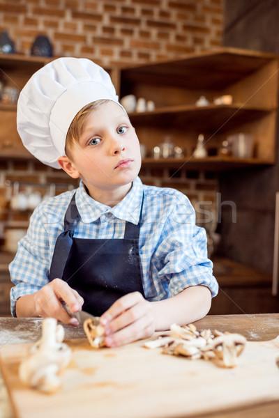 Kicsi fiú szakács sapka vág gombák pizza Stock fotó © LightFieldStudios