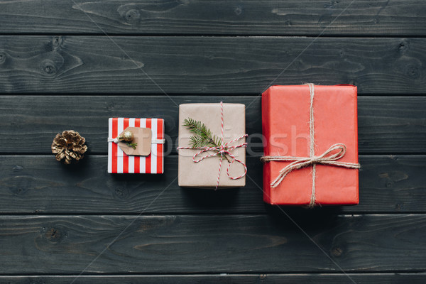christmas gifts in row in table Stock photo © LightFieldStudios