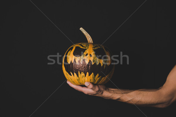 man holding pumpkin with creepy face Stock photo © LightFieldStudios