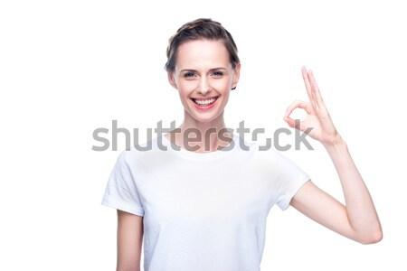Kadın neden imzalamak güzel bir kadın beyaz tshirt Stok fotoğraf © LightFieldStudios