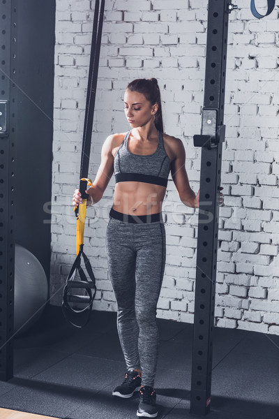 woman near trx gym equipment Stock photo © LightFieldStudios
