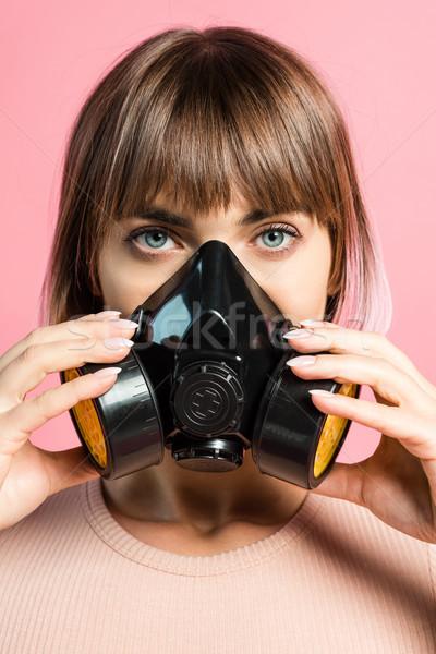 young woman wearing respirator Stock photo © LightFieldStudios