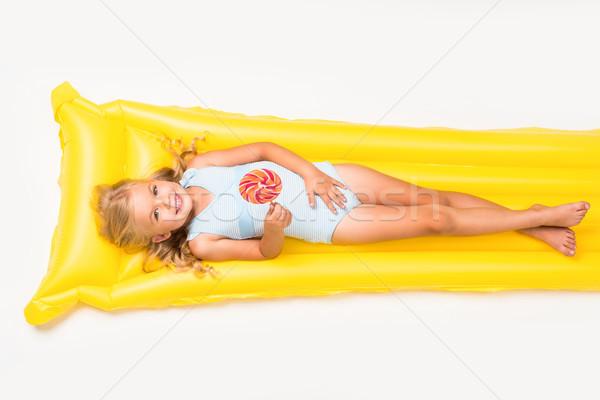 Kid леденец плаванию матрац прелестный улыбаясь Сток-фото © LightFieldStudios