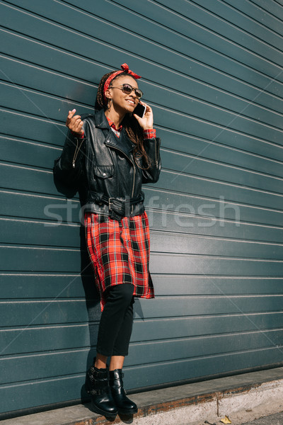 stylish african american girl with smartphone Stock photo © LightFieldStudios