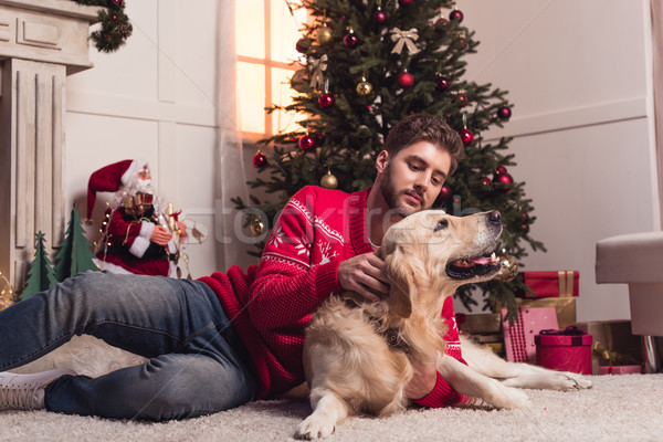 man playing with dog at christmastime Stock photo © LightFieldStudios