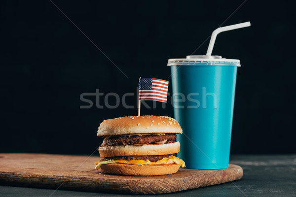 close up view of burger with american flag and soda drink, presidents day celebration concept Stock photo © LightFieldStudios