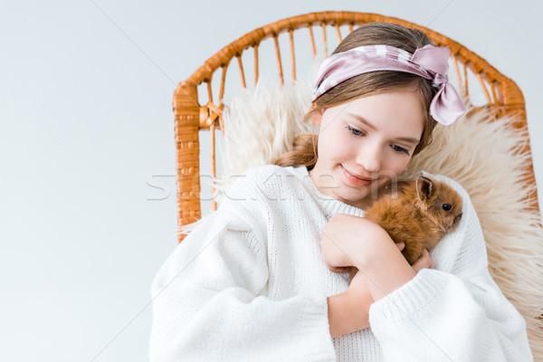 Gyönyörű kislány ölel aranyos szőrös nyúl Stock fotó © LightFieldStudios
