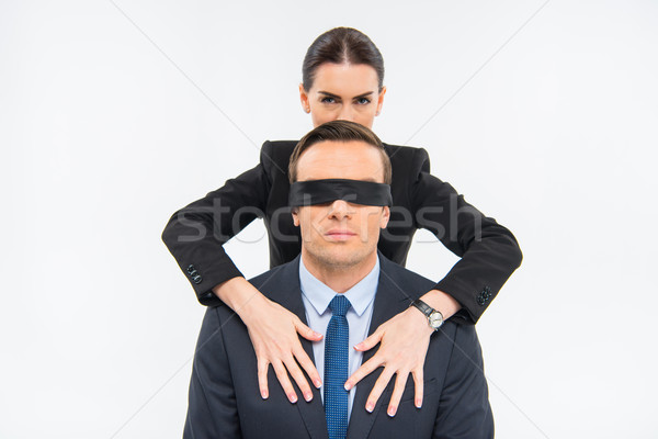 Businessman in blindfold and businesswoman Stock photo © LightFieldStudios
