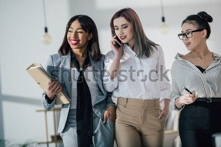 high angle view of three doctors sitting on table in cabinet Stock photo © LightFieldStudios
