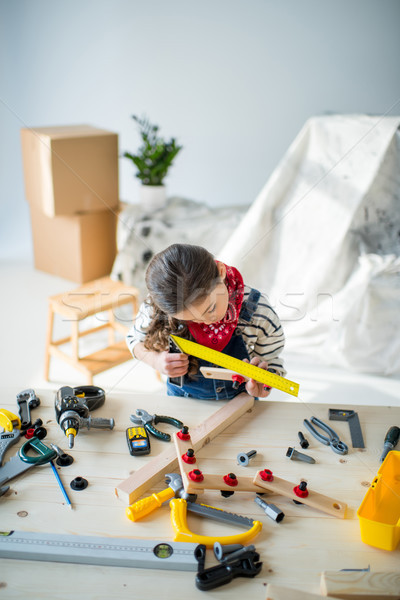 Little girl with tools Stock photo © LightFieldStudios