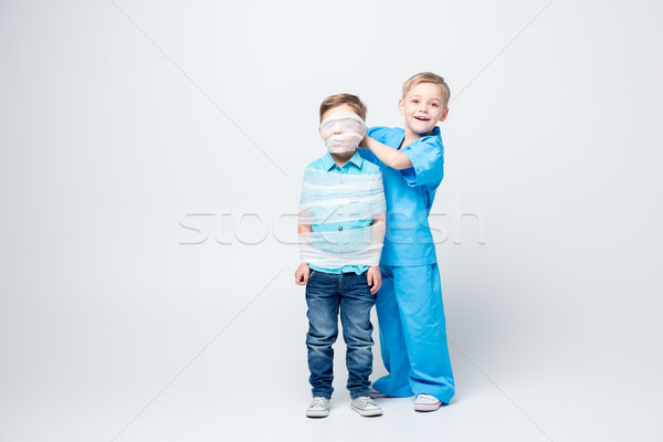 Kids playing doctor and patient Stock photo © LightFieldStudios