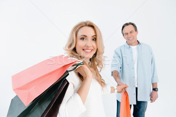 Homem maduro olhando feliz mulher loira Foto stock © LightFieldStudios