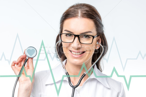 doctor with stethoscope and cardiogram Stock photo © LightFieldStudios