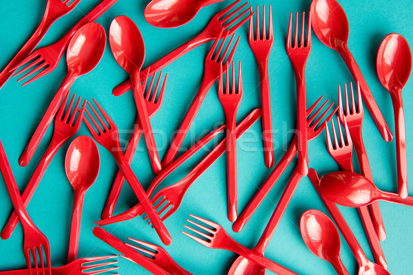top view of set of plastic forks and spoons isolated on blue Stock photo © LightFieldStudios